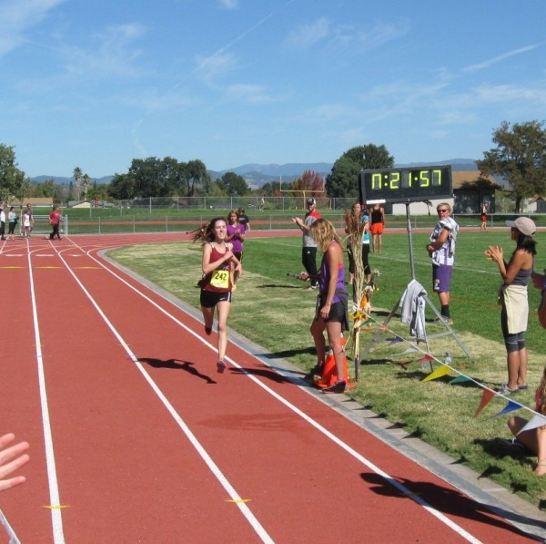 Healdsburg's Ana Drake-Tripp crossing the finish in first.